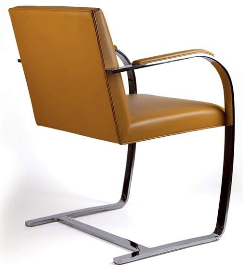 fauteuil brno du designer Ludwig Mies van der ROhe en cuir marron cognac